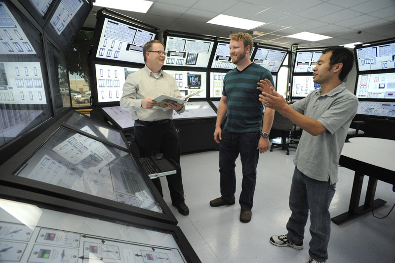 Three men in the Human System Simulation Lab